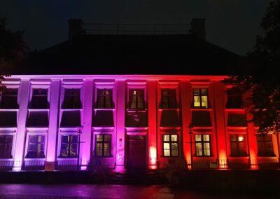 The facade of Gathenhielmska Huset, illuminated at night