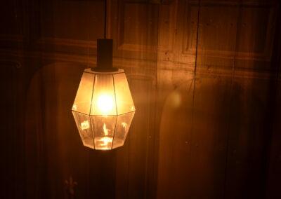 A lampshade, illuminated
