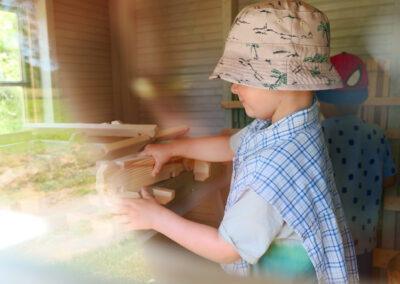 A young boy playing with wooden blocks